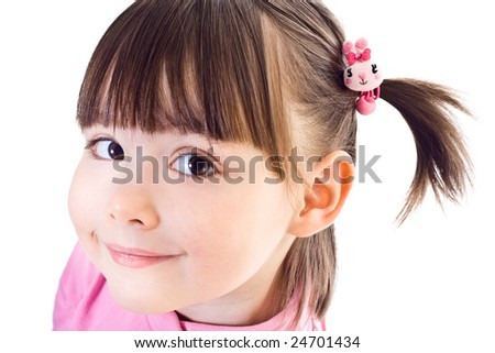 Little smiling girl with ponytails - stock photo