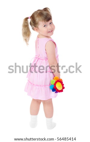 Little smiling girl with toy flower isolated