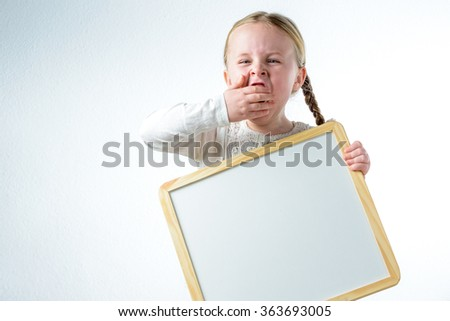 Little smiling girl withe copy space board - stock photo