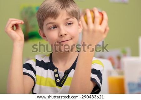 Little smiling male child and fresh fruit - stock photo