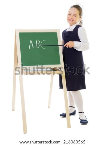 Little smiling schoolgirl with blackboard isolated - stock photo