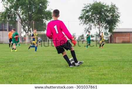 little soccer goalkeeper with gloves - stock photo