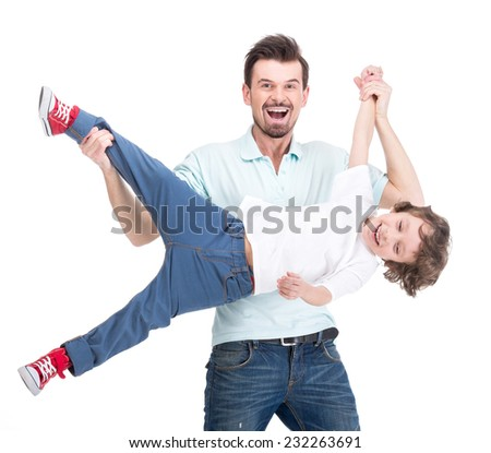 Little son and dad are having fun pastime isolated on white background. - stock photo