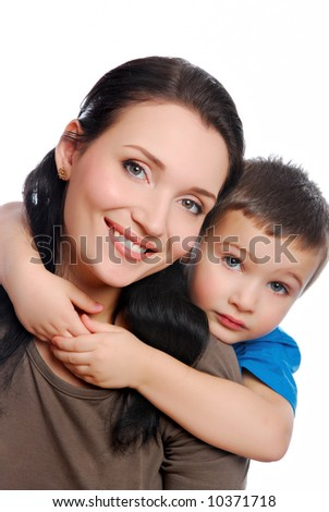 little son embracing his beautiful young mother - stock photo