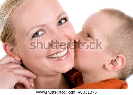 Little son kissing his mother on the cheek.