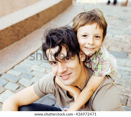 little son with father in city hagging and smiling, casual look outside playing, happy real family, lifestyle people concept