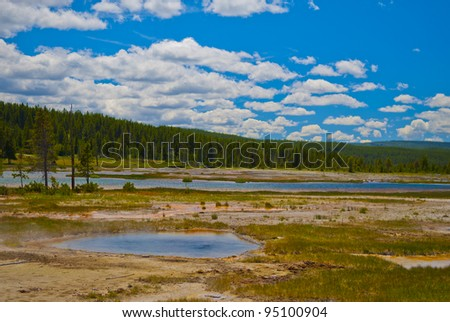 Little steaming pond along the firehole road in yellowstone national park - stock photo