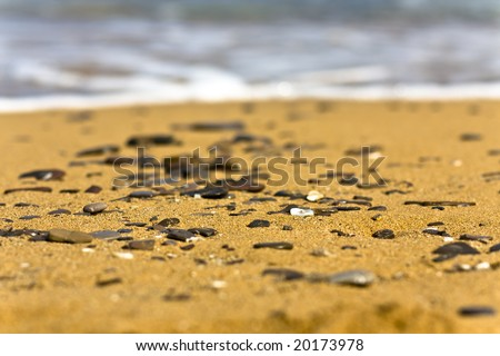 Little stones on the sand of a beach in Menorca - stock photo