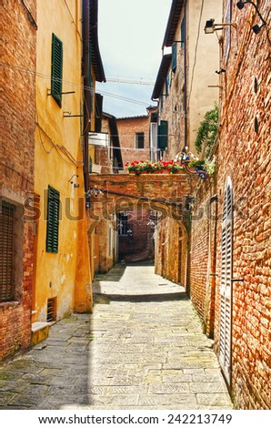 Little street in the old town in Siena, Tuscany, Italy - stock photo