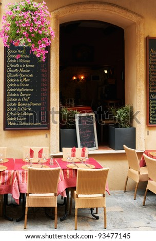 Little street restaurant in Aix en Provnece town , South France - stock photo