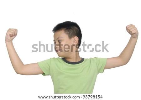 Little strong boy showing his muscles isolated against white background - stock photo