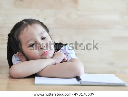 little student asian girl boring study lie down on a table