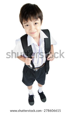 Little student boy in uniform on white background - stock photo