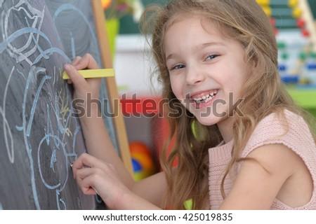little student girl at art class - stock photo