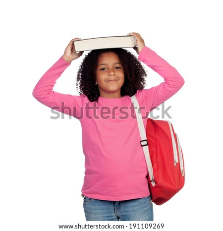 Little student girl with a book on her head isolated on a white background - stock photo