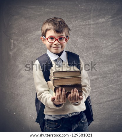 little student holding books - stock photo