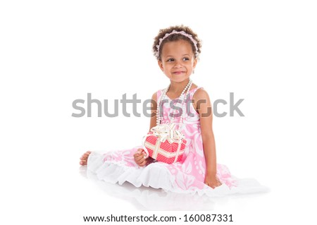 Little surprised mulatto girl with gifts.