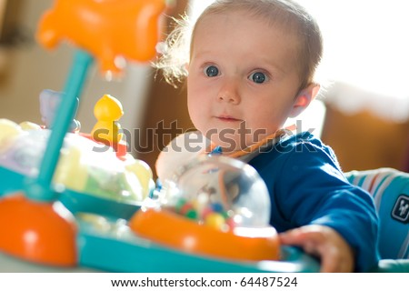 little sweet baby in the baby walker - stock photo