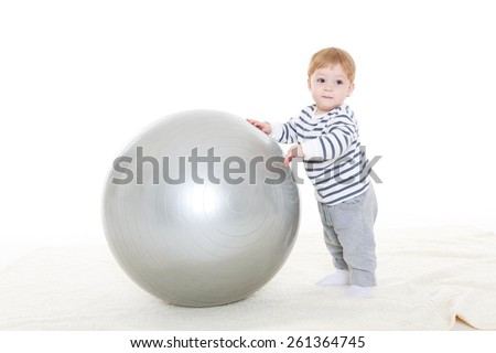 Little sweet boy plays  with fitness ball on a white background. Healthy lifestyle. - stock photo