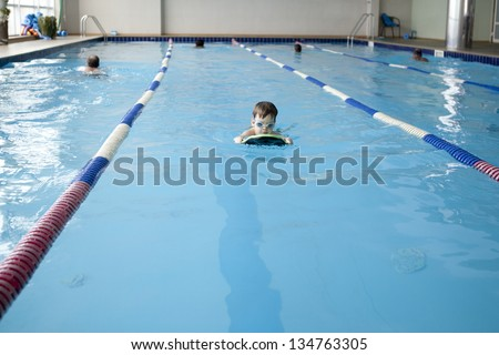 little swimmer in swimming pool - stock photo
