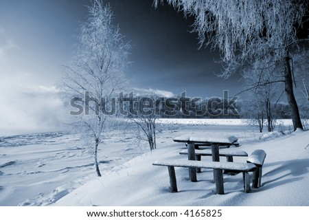 Little table and bench - stock photo