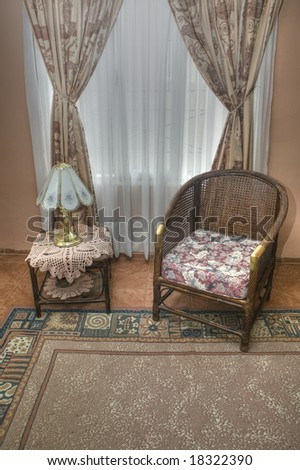 Little table and wicker sofa on the living room - stock photo