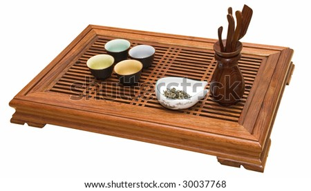 Little table for tea with cups and tools - stock photo