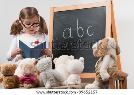Little teacher - lesson (no-name toys) - stock photo