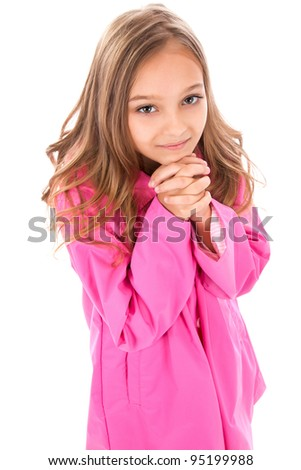 little teenage girl in pink coat begging asking for something, looking up to camera, top angle view, isolated over white background - stock photo