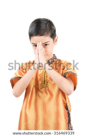 Little Thai boy in classic national  costume with praying