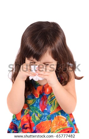 Little three year old girl having the sniffles or sneezing from being sick or allergies - stock photo