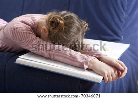 little tired girl sleep at book - stock photo