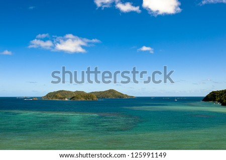 Little Tobago and sailboat - stock photo