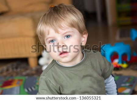 little baby boy blue eyes blond stock photo 112445942