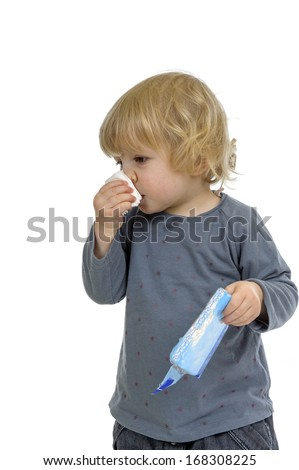 little toddler hang a cold, isolated on white background - stock photo