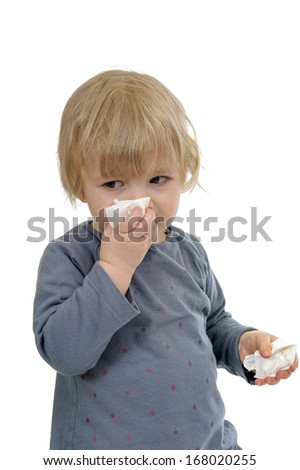 little toddler having a cold, isolated on white background