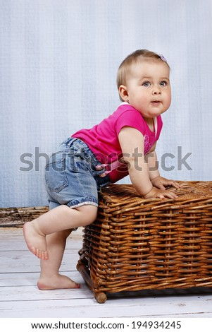 Little toddler trying to take his first steps - stock photo
