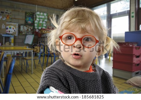 little toddler with glasses on black - stock photo
