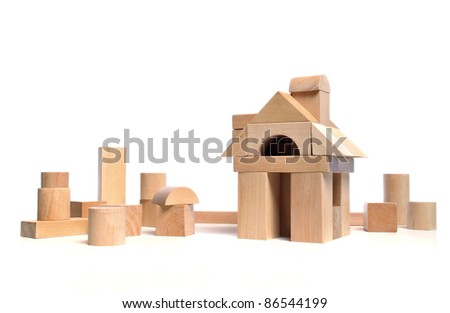 Little town house of natural colored toy blocks on white background - stock photo