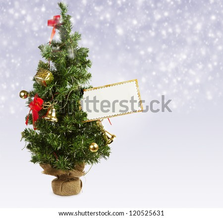 Little toy christmas tree with greeting postcard blank - stock photo