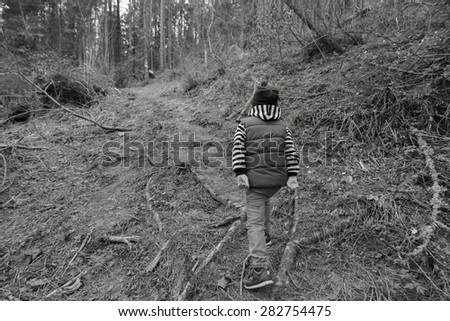 Little traveler. Little boy is resting in the forest. Travel, active children's recreation.