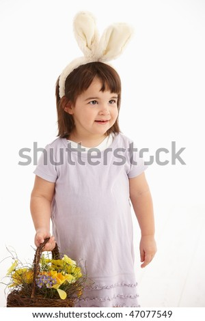 Little two years old girl wearing Easter bunny ears, isolated on white background. - stock photo