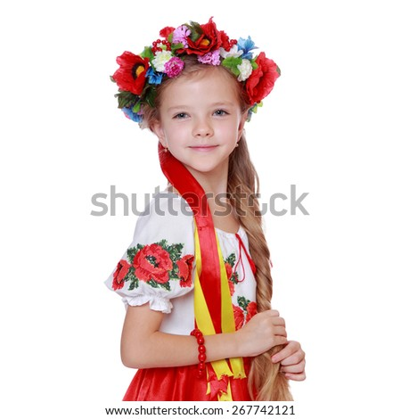 Little ukrainian girl/Cheerful little girl in a bright Ukrainian national costume - stock photo