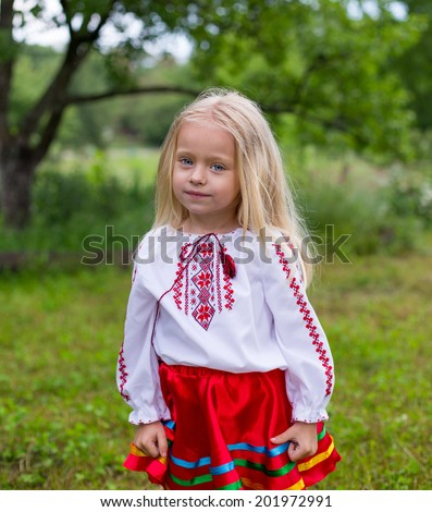 Little ukrainian girl stand and watching you - stock photo