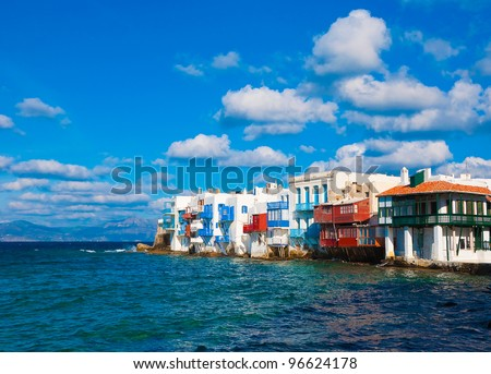 Little Venice in the surf azure sea on the island of Mykonos in the clouds - stock photo
