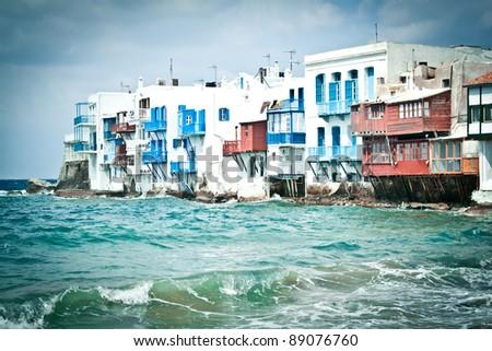 Little Venice, Mykonos, Greece, on a stormy day. - stock photo
