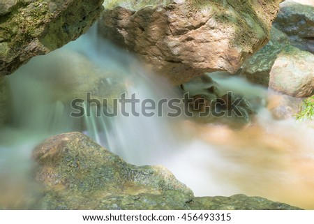 Little Waterfall in Forest, Moss Covered Rocks - stock photo