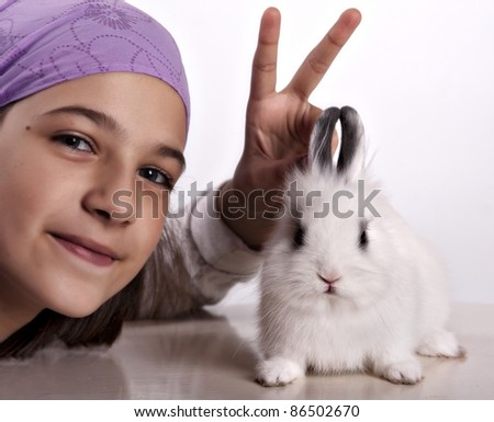 Little white rabbit and a girl posing, clipping path included