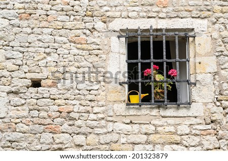 Little window decorated by flowers, Yevre le chatel, Loiret, France - stock photo