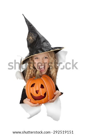 Little witch in a black hat with web and spider with a pumpkin in the paper hole.